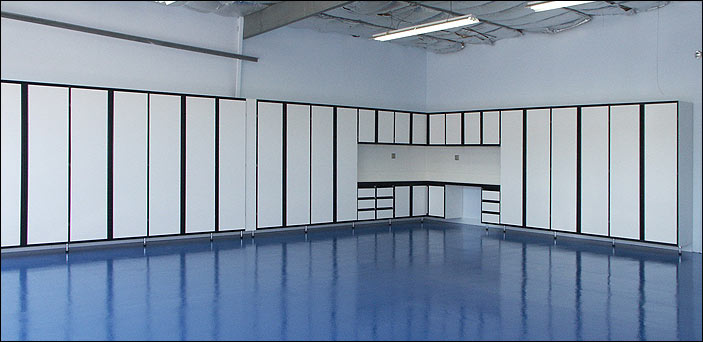 Our standard White Melamine Cabinets with custom blue epoxy floor.